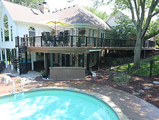 Curved deck with spiral stairs and bar St Louis