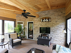 Screened & Covered Deck with a Stone Wall in St. Louis, MO